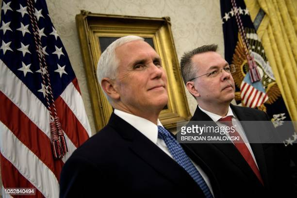 US Vice President Mike Pence and pastor Andrew Brunson listen while US President Donald Trump speaks during a bill signing for S3021 in the Oval...