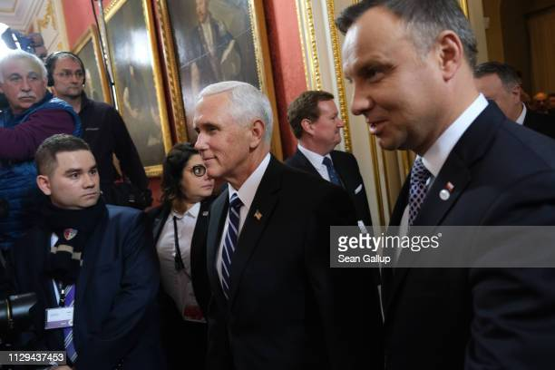 S Vice President Mike Pence and Polish President Andrzej Duda arrive for a group photo prior to the dinner on the opening evening of the Ministerial...