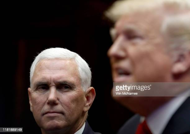 S Vice President Mike Pence and President Donald Trump listen during a conference call with the International Space Station on October 18 2019 in...