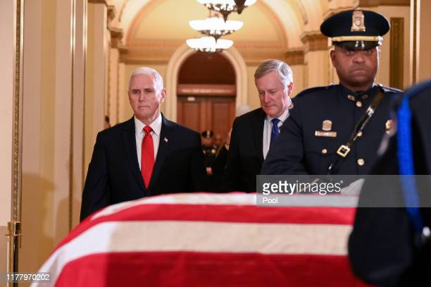 Vice President Mike Pence and Rep Mark Meadows pay their respects at the casket of the late Rep Elijah Cummings as he lies in state in the Will...