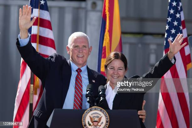Vice President Mike Pence and second lady Karen Pence and wave to supporters during a 'Make America Great Again' event at TYR Tactical on October 8,...