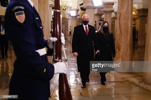 Vice President Mike Pence and Second Lady Karen Pence arrive in the Crypt of the US Capitol for President-elect Joe Biden's inauguration ceremony to...