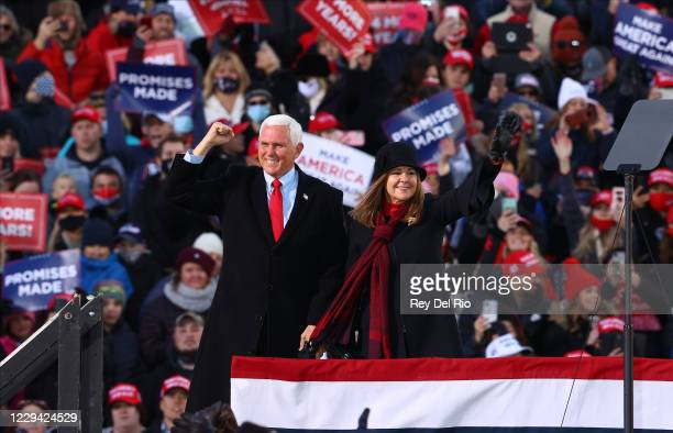 Vice President Mike Pence and second lady Karen Pence greet supporters at a rally on November 2, 2020 in Traverse City, Michigan. President Trump and...