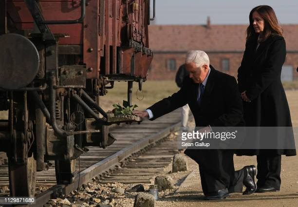 Vice President Mike Pence and Second Lady Karen Pence lay flowers at a railway once car used to transport inmates at the Auschwitz-Birkenau...