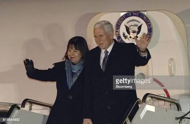 US Vice President Mike Pence and Second Lady Karen Pence wave as they exit Air Force Two while arriving at US Yokota Air Base in Fussa Tokyo...