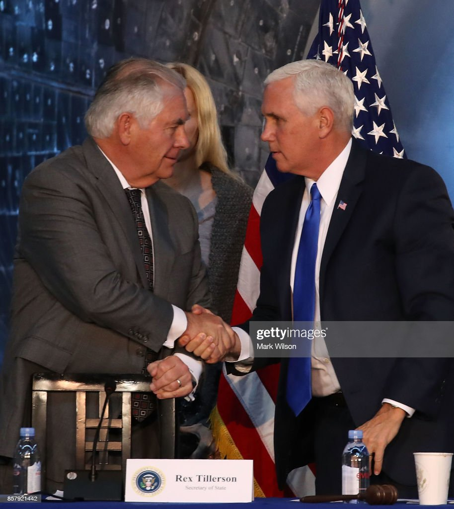 Vice President Mike Pence (R), and Secretary of State Rex Tillerson shake hands at the end of the inaugural meeting of the National Space Council, titled 'Leading the Next Frontier' at the National Air and Space Museum, Steven F. Udvar-Hazy Center, October 5, 2017 in Chantilly, Virginia. Originally formed in 1958, this is the first meeting of the newly reestablished council in 20 years.