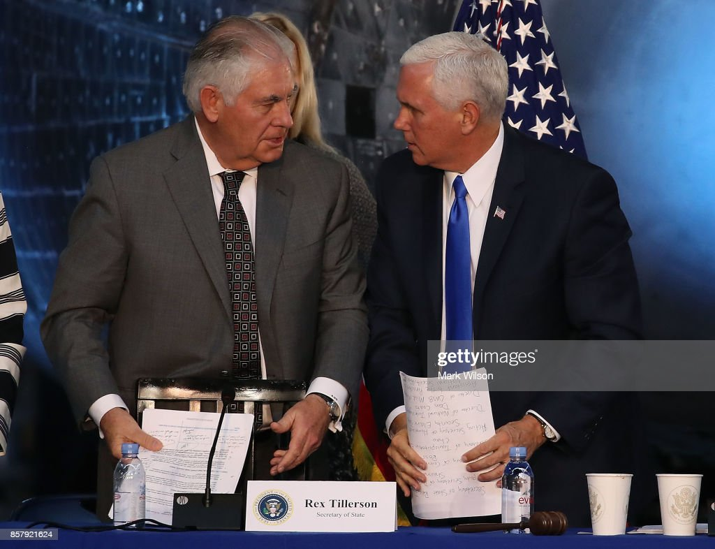 Vice President Mike Pence (R), and Secretary of State Rex Tillerson talk at the end of the inaugural meeting of the National Space Council, titled 'Leading the Next Frontier' at the National Air and Space Museum, Steven F. Udvar-Hazy Center, October 5, 2017 in Chantilly, Virginia. Originally formed in 1958, this is the first meeting of the newly reestablished council in 20 years.