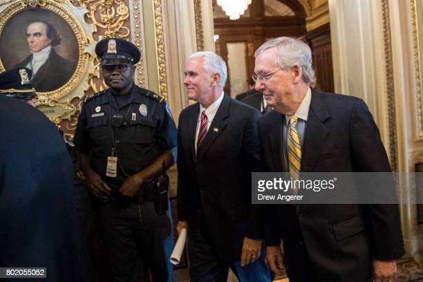 Vice President Mike Pence and Senate Majority Leader Mitch McConnell head to a closeddoor Senate GOP conference meeting on Capitol Hill June 27 2017...