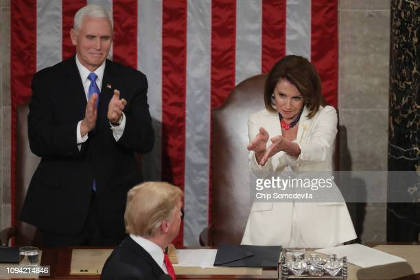 Vice President Mike Pence and Speaker Nancy Pelosi greet President Donald Trump just ahead of the State of the Union address in the chamber of the US...