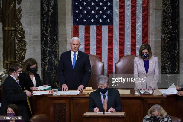 Vice President Mike Pence and Speaker of the House Nancy Pelosi, D-Calif., read the final certification of Electoral College votes cast in November's...