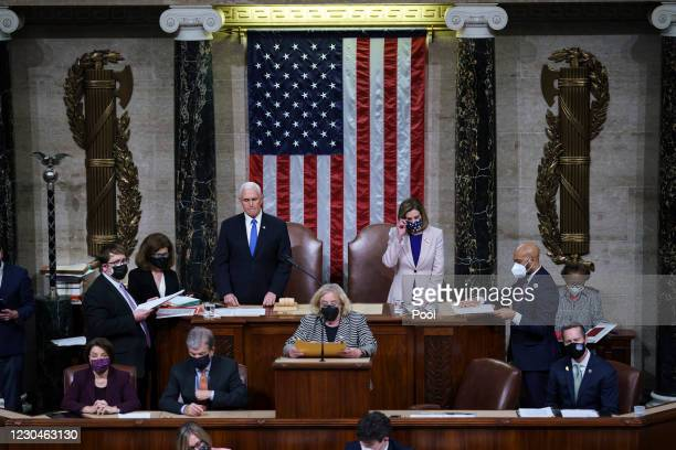 Vice President Mike Pence and Speaker of the House Nancy Pelosi, D-Calif., prepare to read the final certification of Electoral College votes cast in...