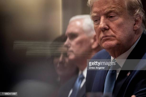 US Vice President Mike Pence and US President Donald Trump attend a meeting about the Governors Initiative on Regulatory Innovation in the Cabinet...