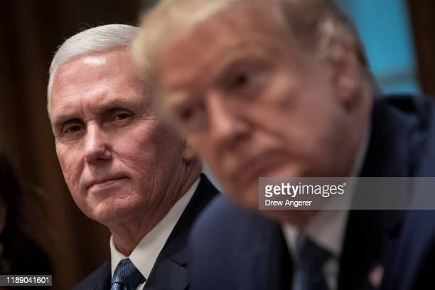 US Vice President Mike Pence and US President Donald Trump listen during a meeting about the Governors Initiative on Regulatory Innovation in the...