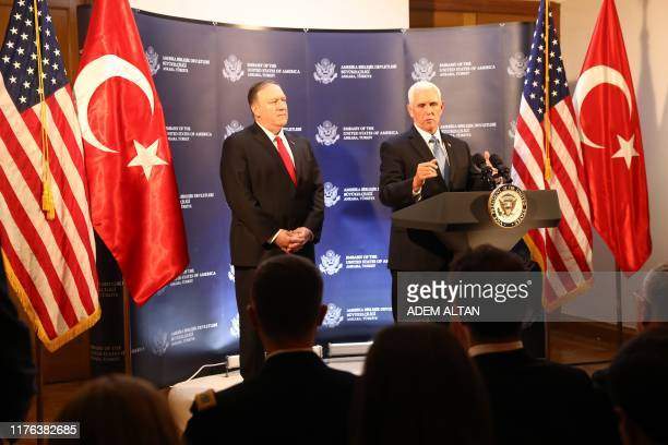 Vice President Mike Pence and US Secretary of State Mike Pompeo attend a press conference after a meeting with Turkish President, in Ankara, Turkey,...