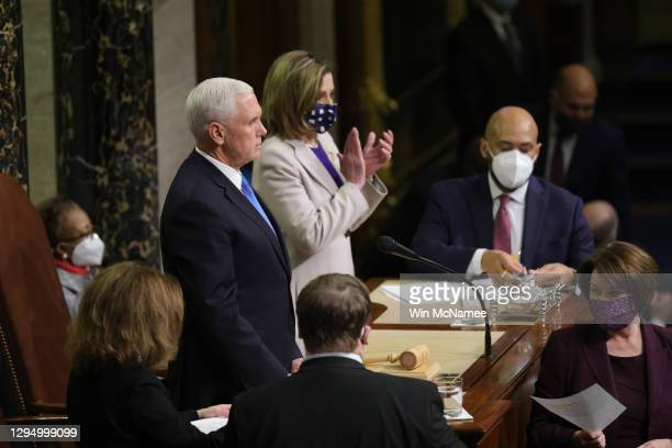 Vice President Mike Pence and U.S. Speaker of the House Nancy Pelosi look on as the the count of electoral votes continues in the House Chamber...