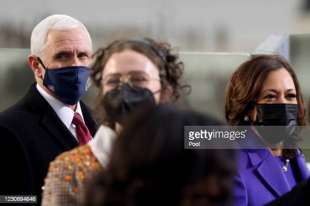 Vice President Mike Pence and Vice President-elect Kamala Harris during the inauguration of President-elect Joe Biden on the West Front of the U.S....