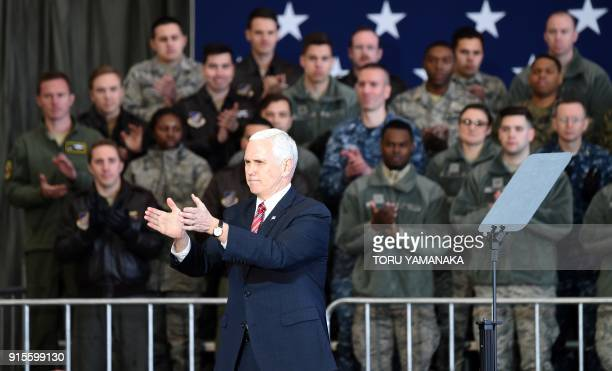 US Vice President Mike Pence applaudes after addressing US soldiers at Yokota Air Base at Fussa near Tokyo on February 8 2018 Pence is on the last...