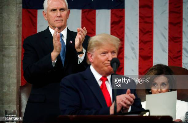 Vice President Mike Pence applauds as House Speaker Nancy Pelosi remains seated during U.S. President Donald Trump's State of the Union address in...
