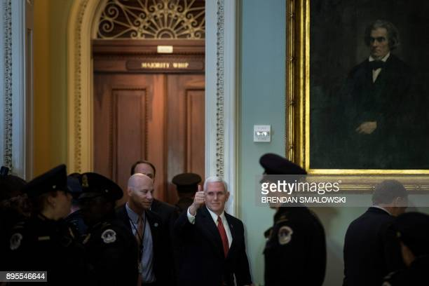 Vice President Mike Pence arrives for a luncheon with Senate Republicans as lawmakers continue to work for tax reform legislation on Capitol Hill...