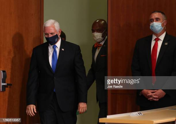 Vice President Mike Pence arrives for a press conference at the the University of Miami Miller School of Medicine on July 27 2020 in Miami Florida...