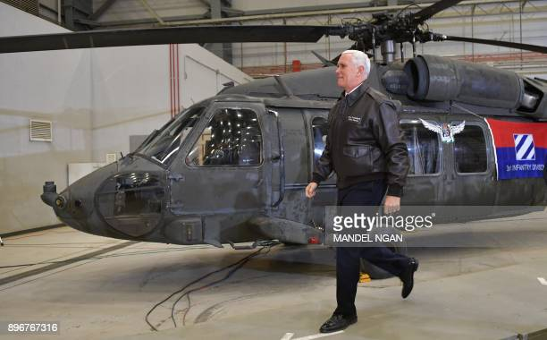 US Vice President Mike Pence arrives on stage to address troops in a hangar at Bagram Air Field in Afghanistan on December 21 2017 POOL / AFP PHOTO /...