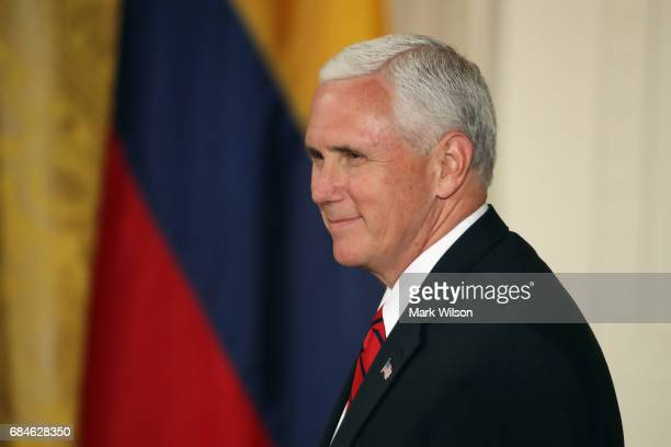 Vice President Mike Pence arrives to a news conference with Colombian President Juan Manuel Santos and US President Donald Trump hold a joint news...