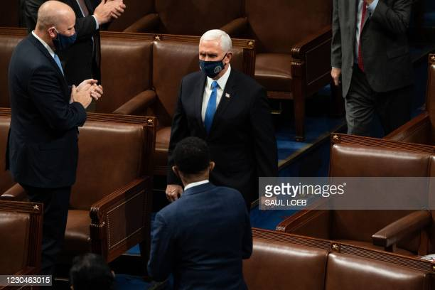 Vice President Mike Pence arrives to preside over a joint session of Congress counting the electoral votes for President after they resumed the...