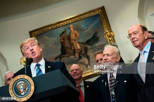 US Vice President Mike Pence Buzz Aldrin former NASA astronaut and second man on the moon US Secretary of Commerce Wilbur Ross and others listen as...