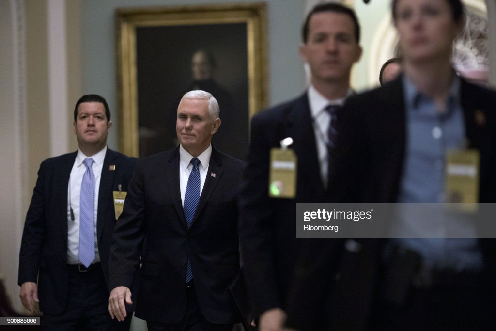 U.S. Vice President Mike Pence, center, arrives to a swearing in ceremony in the Old Senate Chamber of the U.S. Capitol in Washington, D.C, U.S., on Wednesday, Jan. 3, 2018. Two new Democrats arrived in the U.S. Senate Wednesday, reducing the Republican majority to one vote and lifting the number of women in the chamber to a record level. Photographer: Aaron P. Bernstein/Bloomberg via Getty Images