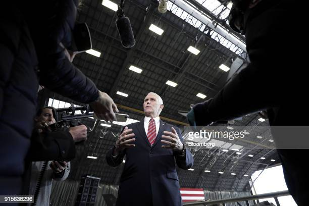 US Vice President Mike Pence center gestures as he speaks to members of the media at US Yokota Air Base in Fussa Tokyo Metropolis Japan on Thursday...