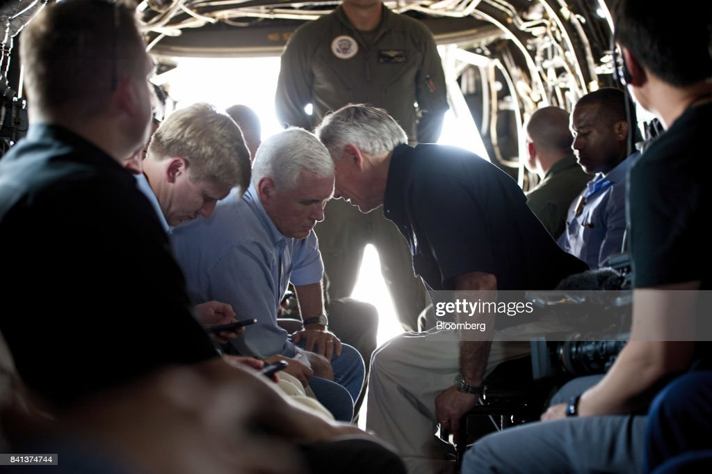 U.S. Vice President Mike Pence, center left, listens to Greg Abbott, governor of Texas, as he travels onboard a helicopter during a trip to survey the damage from Hurricane Harvey in Rockport, Texas, U.S., on Thursday, Aug. 31, 2017. Pence warned that housing for storm victims is emerging as the top long-term challenge in the recovery from Hurricane Harvey as he arrived in Texas on Thursday to view the damage and meet with survivors. Photographer: Eddie Seal/Bloomberg via Getty Images