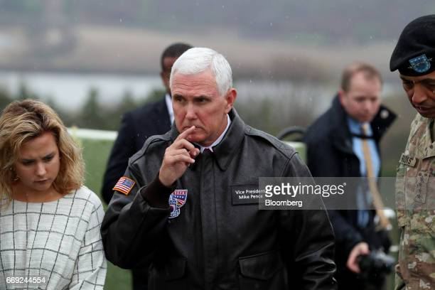 US Vice President Mike Pence center looks across to the north side of the border as his daughter Charlotte left stands beside him at the Observation...
