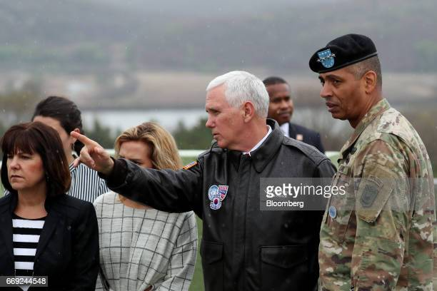 US Vice President Mike Pence center right points as Second Lady Karen Pence left looks across to the north side of the border from the Observation...