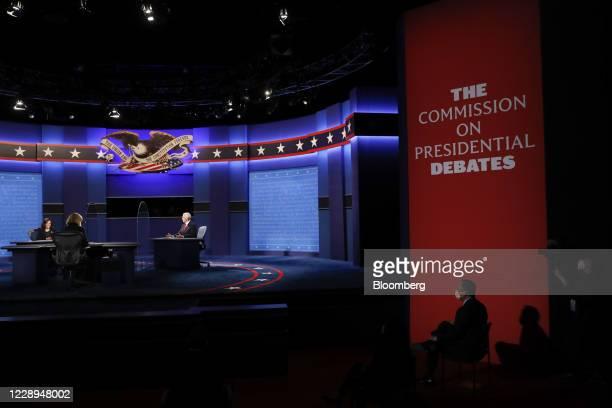 Vice President Mike Pence, center, speaks as Senator Kamala Harris, Democratic vice presidential nominee, left, listens during the U.S. Vice...