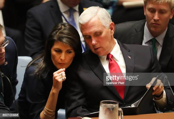 S Vice President Mike Pence confers with US Ambassador to the United Nations Nikki Haley at a Security Council meeting during the 72nd UN General...