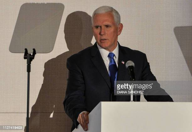 US Vice President Mike Pence delivers a speech during a meeting with Foreign Ministers of the Lima Group Venezuelan opposition leader and...