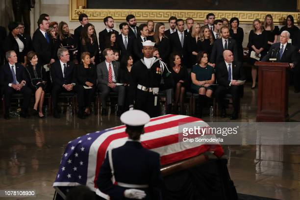 S Vice President Mike Pence delivers remarks during an arrival ceremony for former US President George HW Bush in the US Capitol Rotunda December 03...