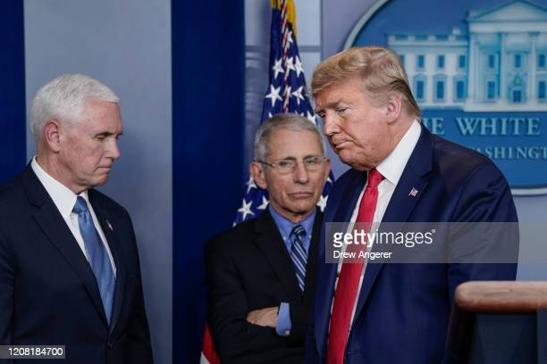 Vice President Mike Pence, Dr. Anthony Fauci, director of the National Institute of Allergy and Infectious Diseases, and U.S. President Donald Trump...