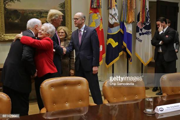 US Vice President Mike Pence embraces House Education and Workforce Committee Chairwoman Virginia Foxx as President Donald Trump greets House Budget...