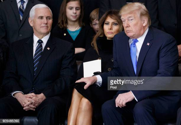 US Vice President Mike Pence first lady Melania Trump and President Donald Trump attend the cermonies as the late evangelist Billy Graham lies in...
