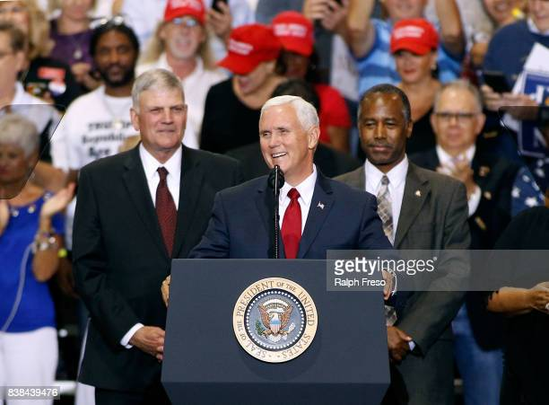 S Vice President Mike Pence flanked by Frankin Graham and Ben Carson speaks to a crowd of supporters for US President Donald Trump at the Phoenix...