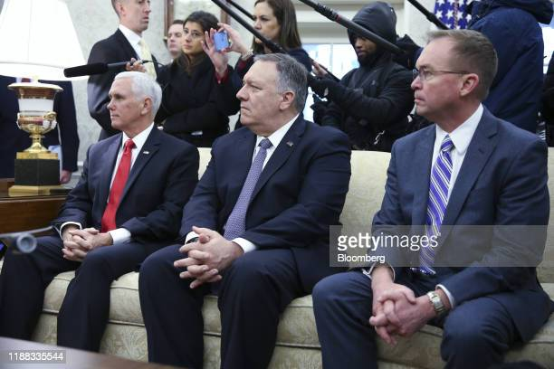 US Vice President Mike Pence from left Mike Pompeo US secretary of state and Mick Mulvaney acting White House chief of staff listen during a meeting...