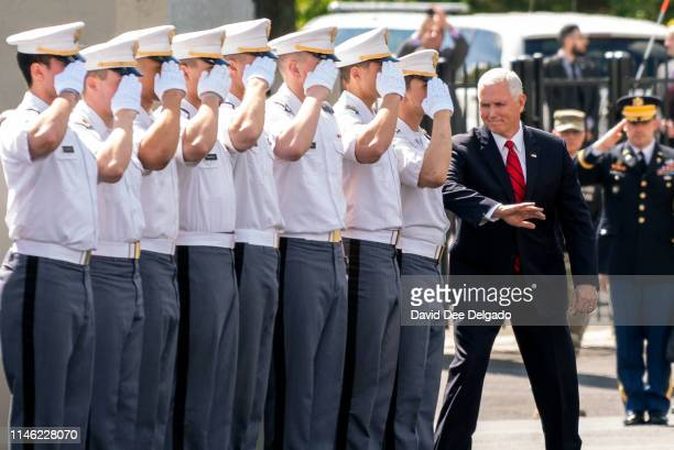 Vice President Mike Pence gestures at a cadet as he arrives at the U.S. Military Academy Class of 2019 graduation ceremony at Michie Stadium on May...