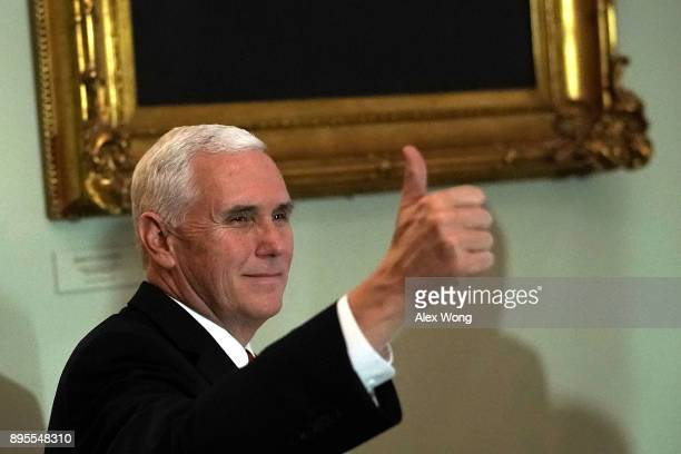 S Vice President Mike Pence gives a thumbs up as he arrives for a Senate Republican policy luncheon at the Capitol December 19 2017 in Washington DC...