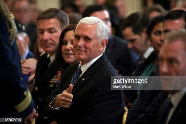 S Vice President Mike Pence gives a thumbs up prior to President Donald Trump's arrival at an event recognizing the Wounded Warrior Project Soldier...