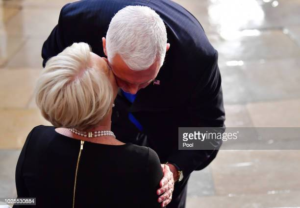 S Vice President Mike Pence greets Cindy McCain as the casket of former Senator John McCain in the Capitol Rotunda lies in state at the US Capitol in...