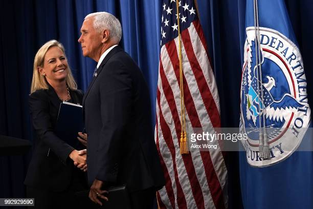 S Vice President Mike Pence greets Homeland Security Secretary Kirstjen Nielsen during a visit to the US Immigration and Customs Enforcement agency...