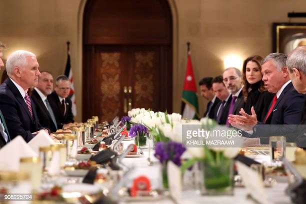 US Vice President Mike Pence has lunch with Jordan's King Abdullah II and his wife Queen Rania in the capital Amman on January 21 2018 / AFP PHOTO /...
