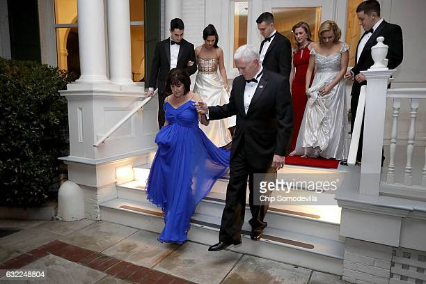 S Vice President Mike Pence helps his wife Karen Pence down the steps of the front porch of the vice presidential residence at the US Naval...
