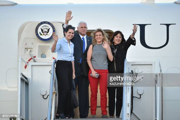 US Vice President Mike Pence his wife Karen and their two daughters Audrey and Charlotte wave as they depart Japan from the US naval air facility in...